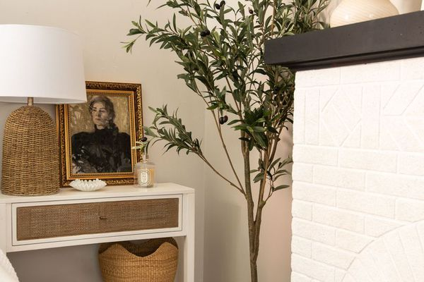 White mantel in bedroom with neutral decor.