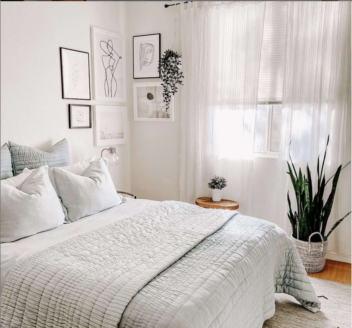 bedroom with corner gallery wall