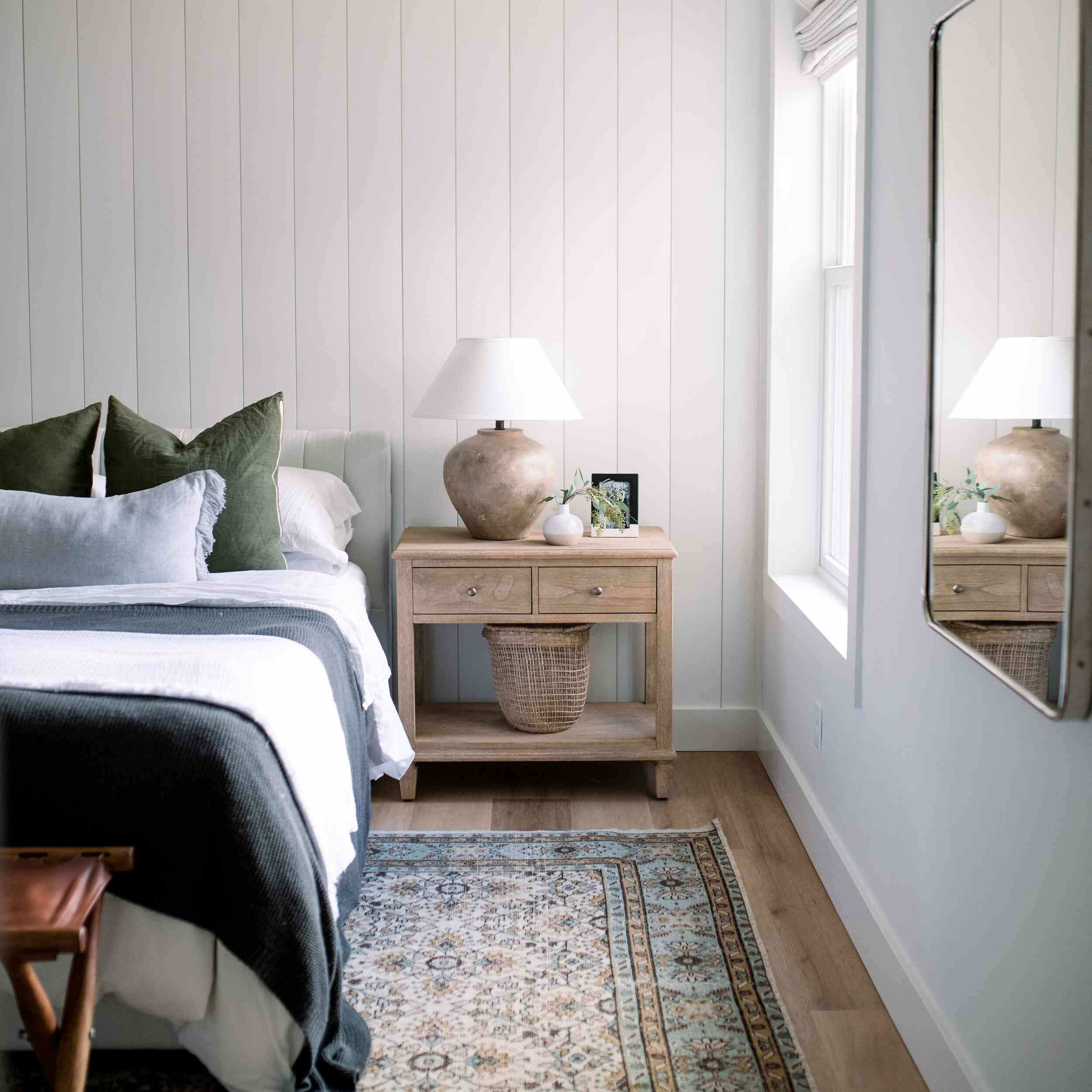 Earthy bedroom with navy accents