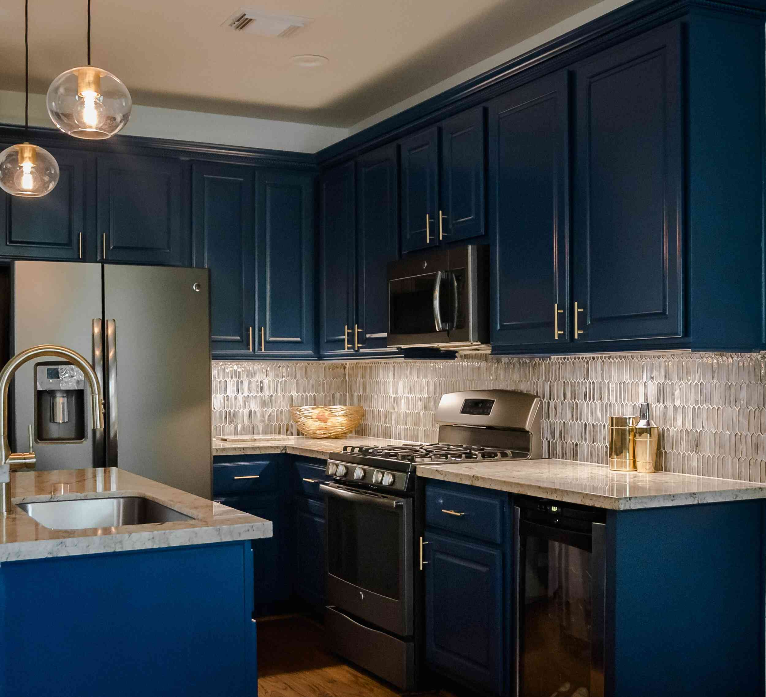 Richly colored blue kitchen cabinets.