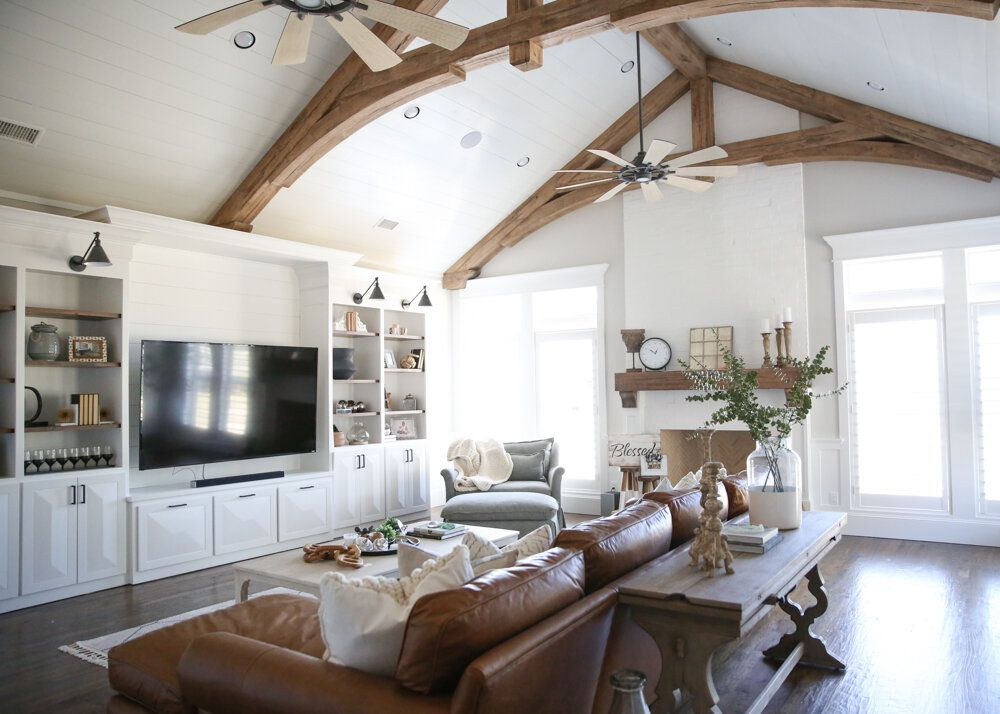 Living room with vaulted ceilings and wooden beams.