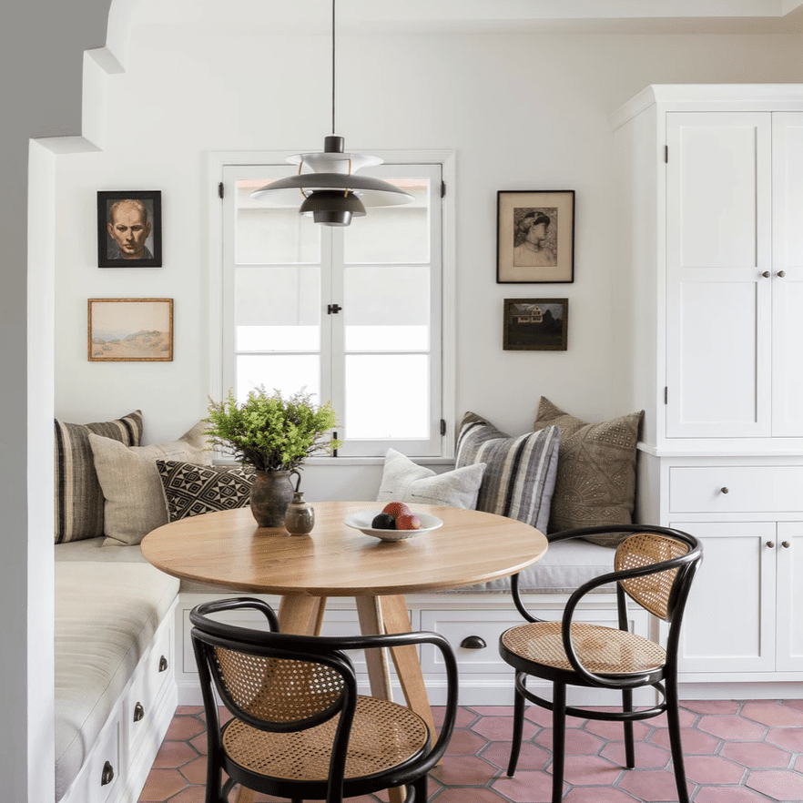 A kitchen corner with a built-in booth and dining nook
