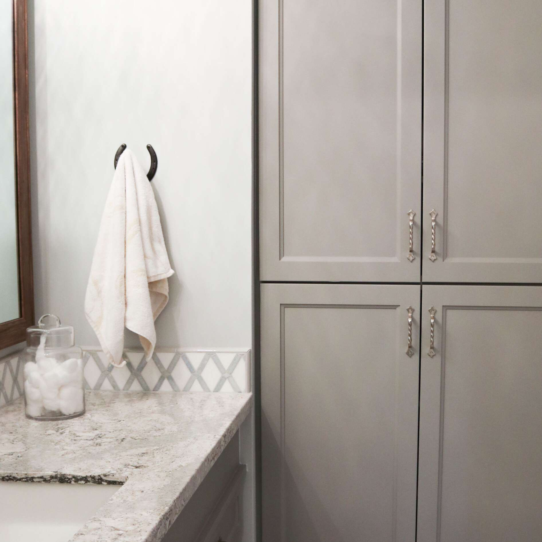 Marble sink with gray cabinets