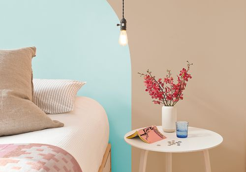 Bedroom with teracotta and blue paint