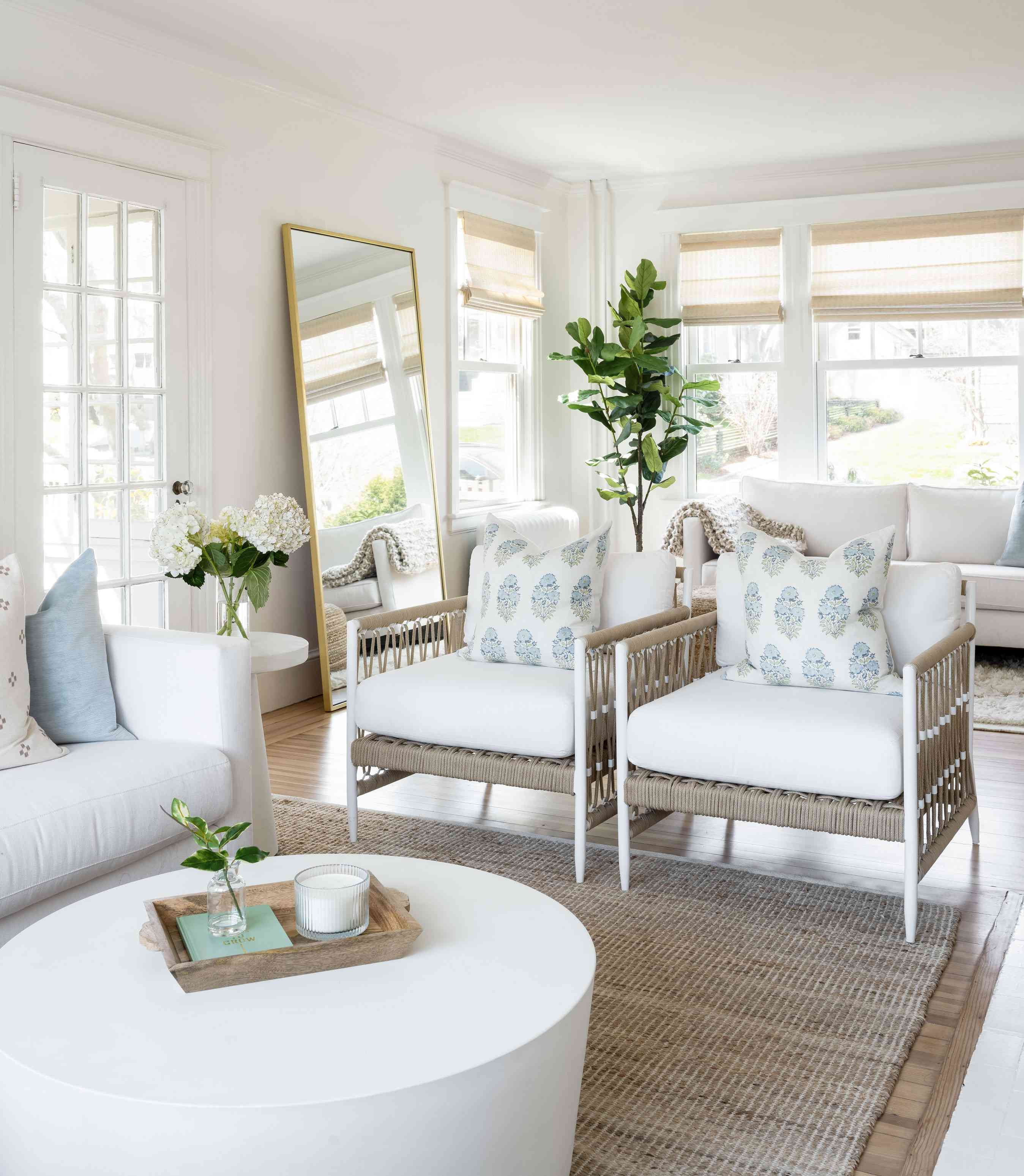 newport beach house living room - leaning mirror and white accent chairs