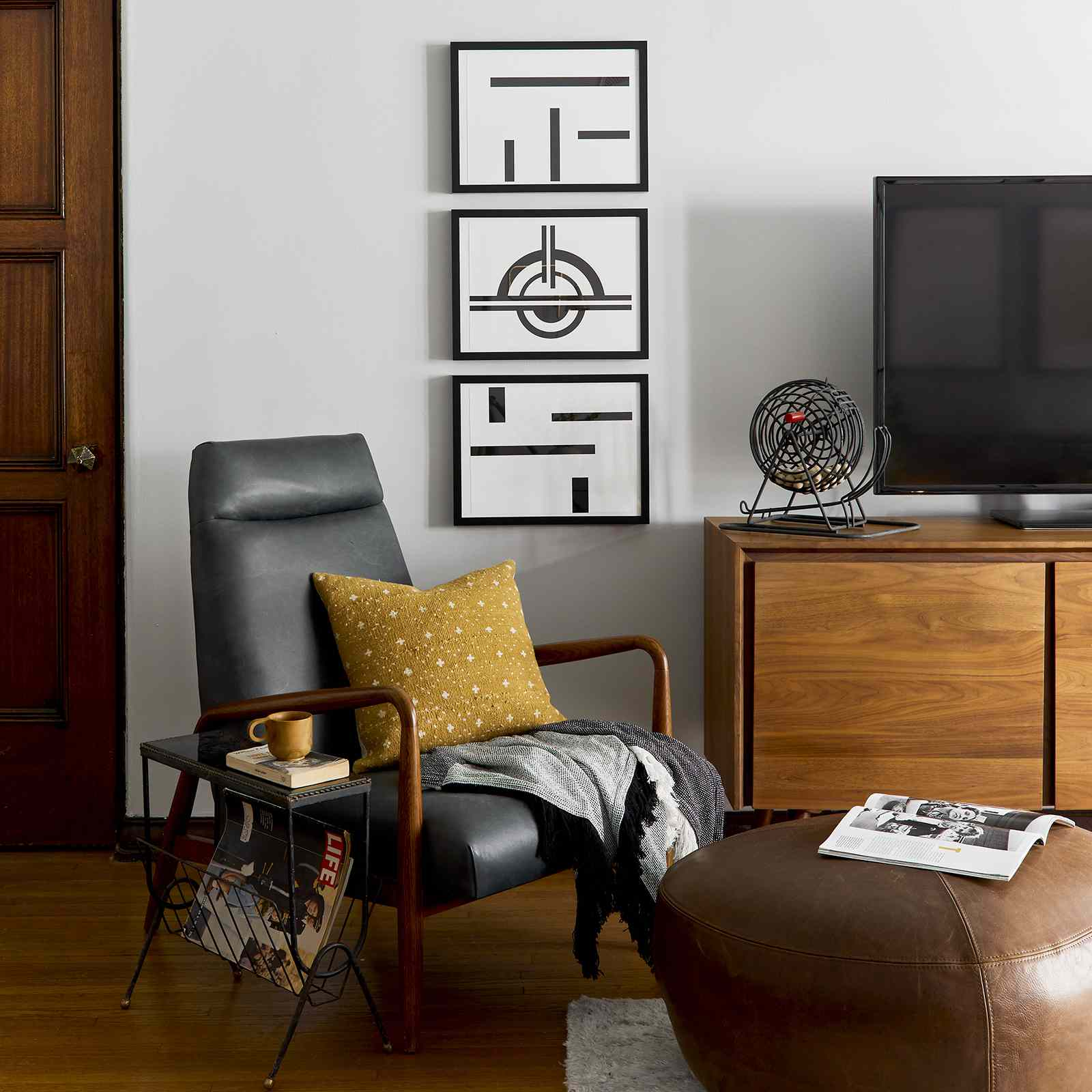best living room ideas - reading nook with ottoman, comfy chair and magazine rack