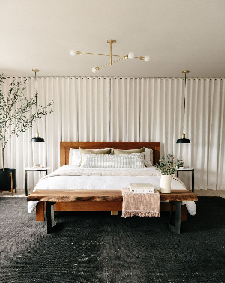 Chic neutral bedroom with wall-to-wall drapes.