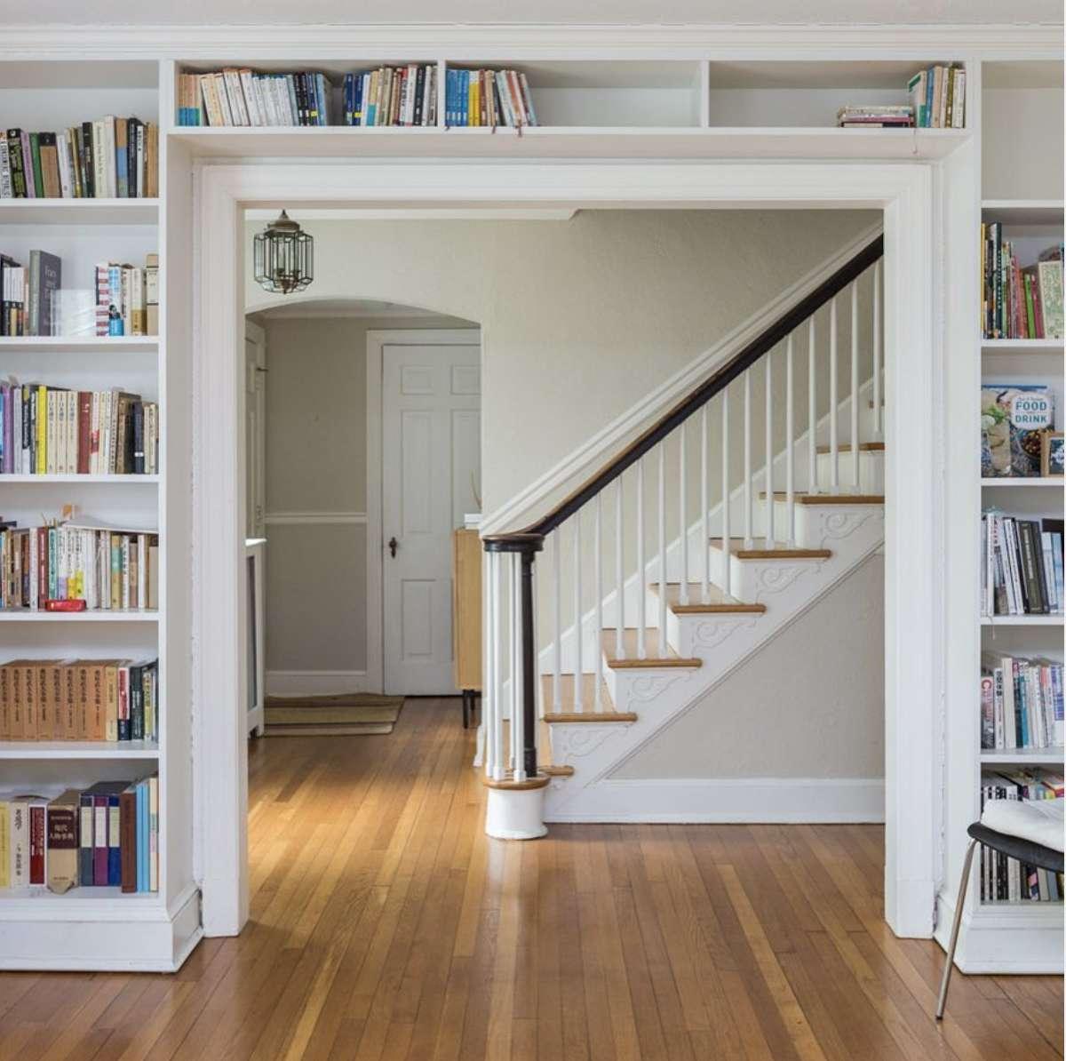 open doorway with bookshelves all the way around