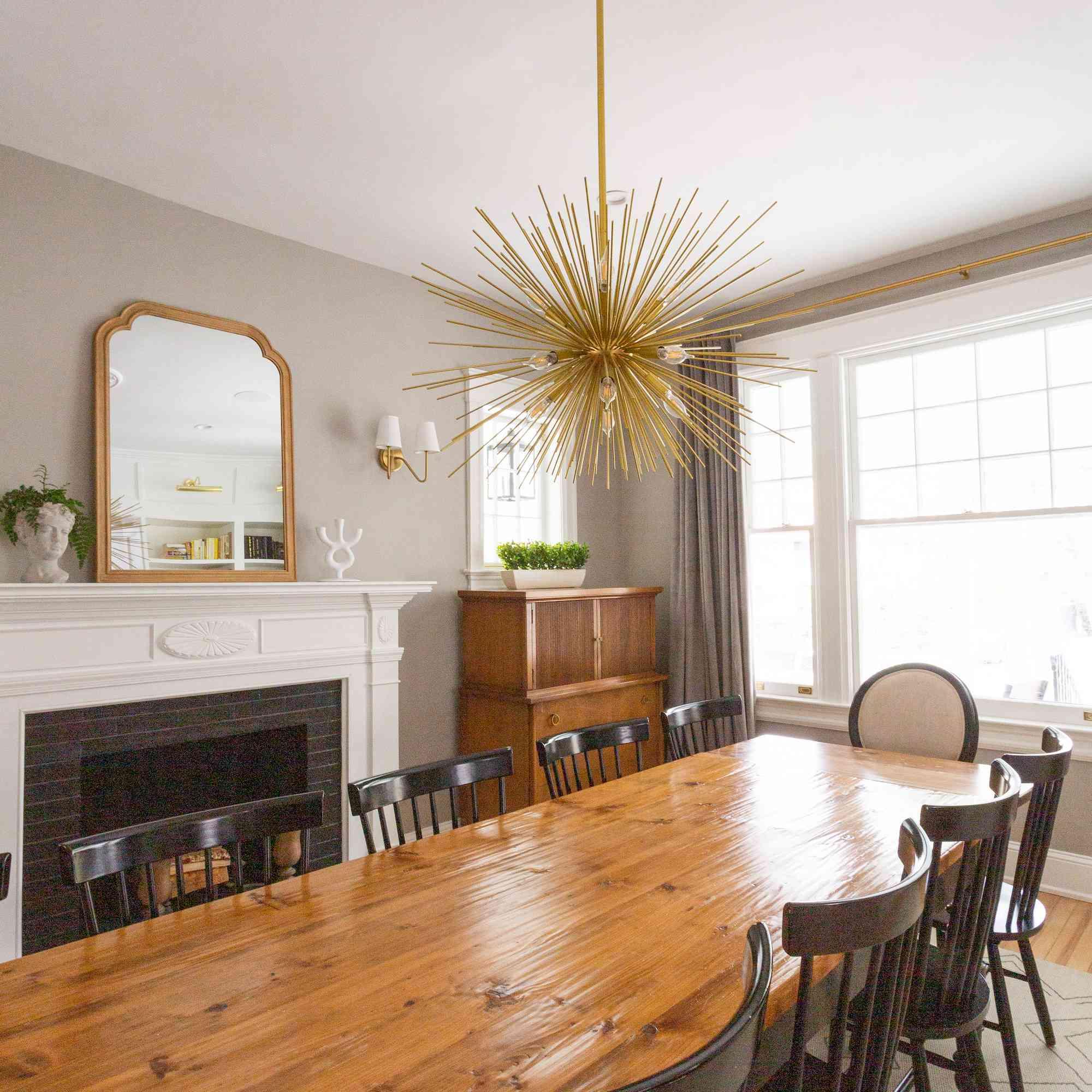 Dining room with starburst pendant light fixture.