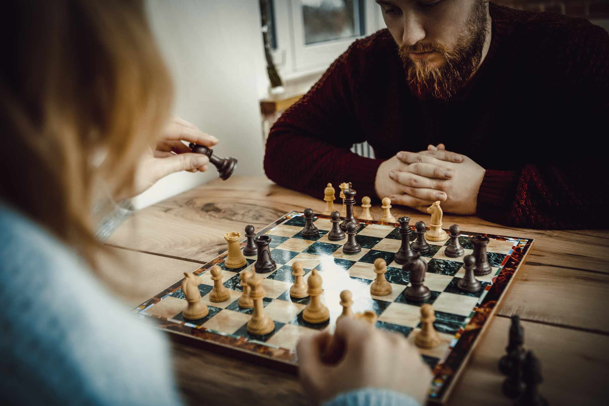 Young people play chess