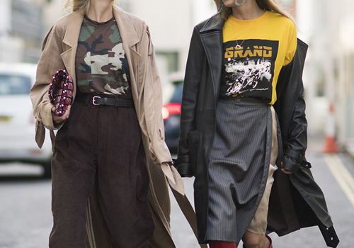 two women walking down a city street