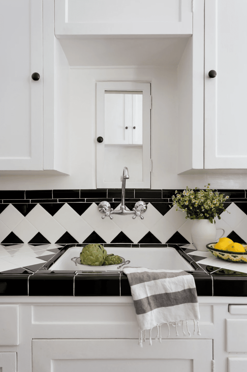 A backsplash boasting a DIY print, made from differently shaped black and white tiles