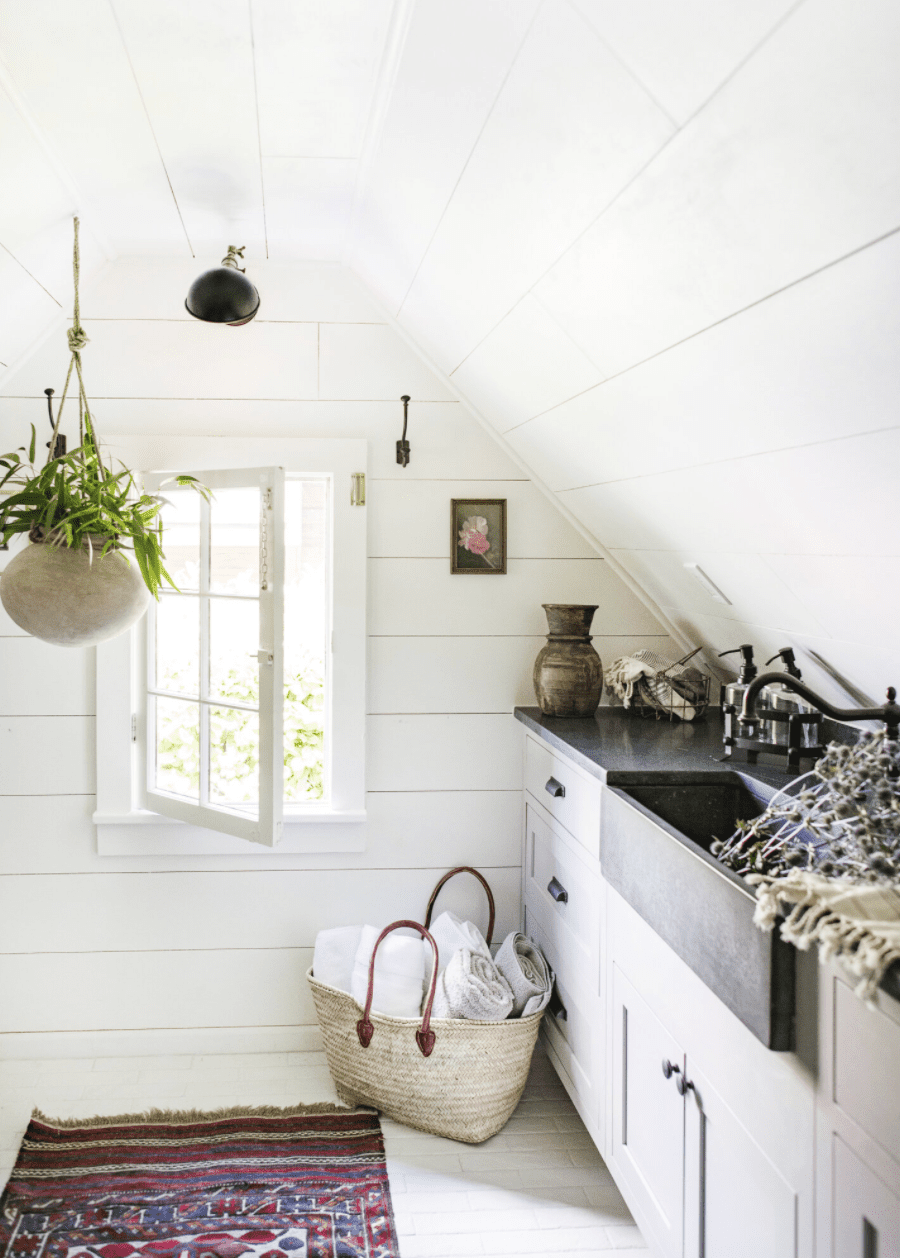 A small kitchenette tucked under a slanted ceiling
