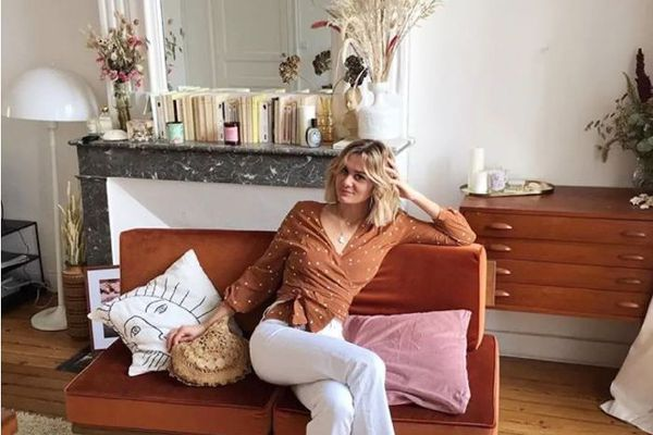 French woman in living room