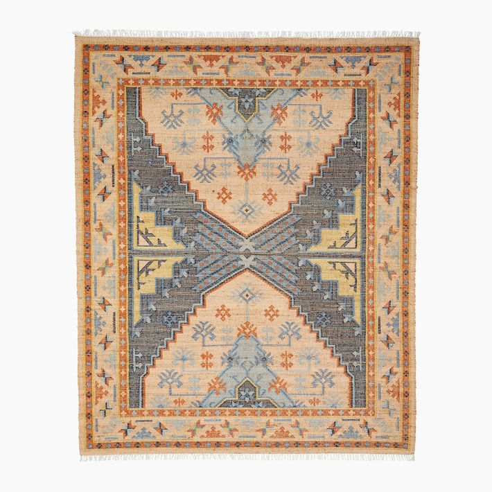 An orange, blue, and yellow printed rug, currently for sale at West Elm