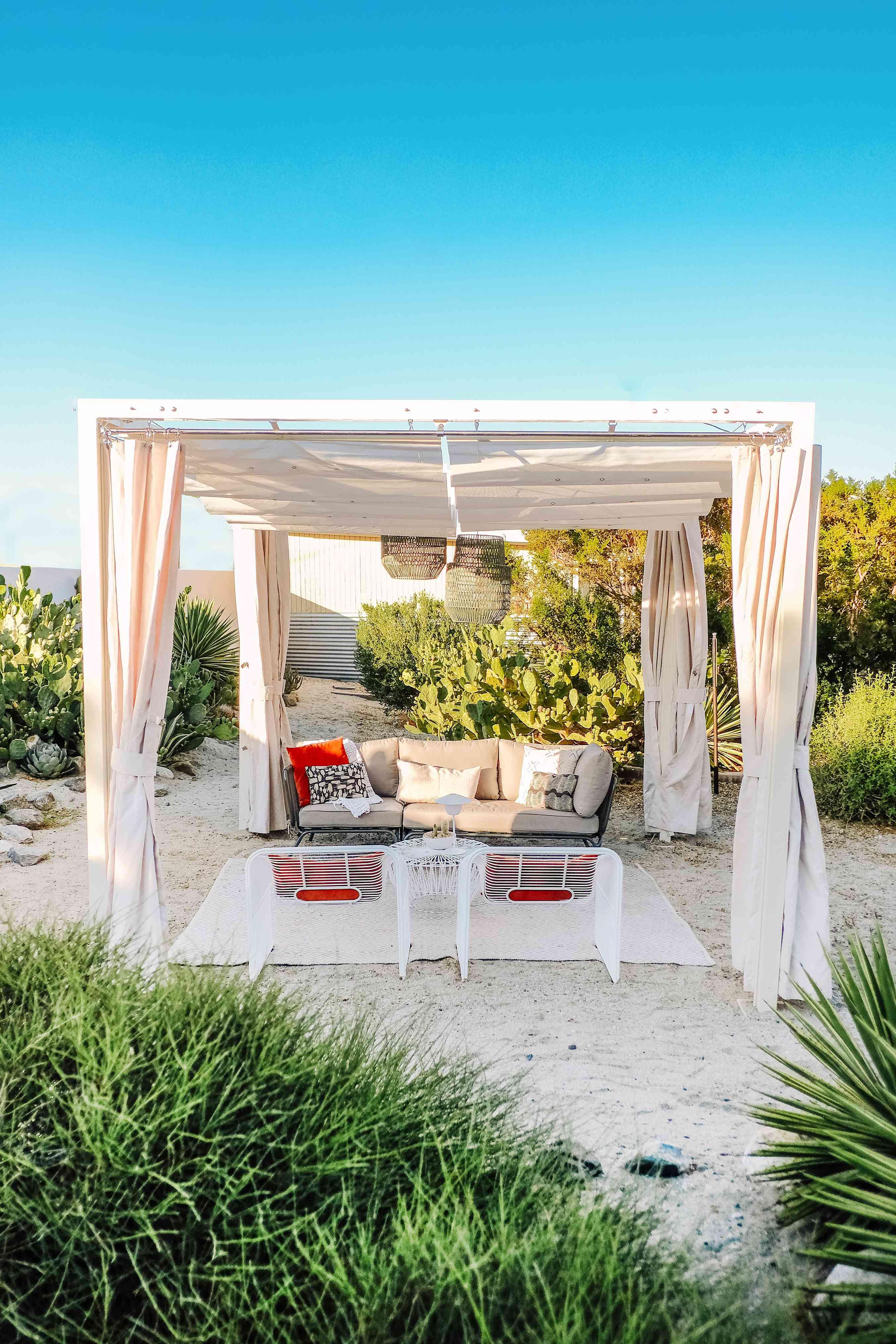 A canopy creates shade in a desert yard.
