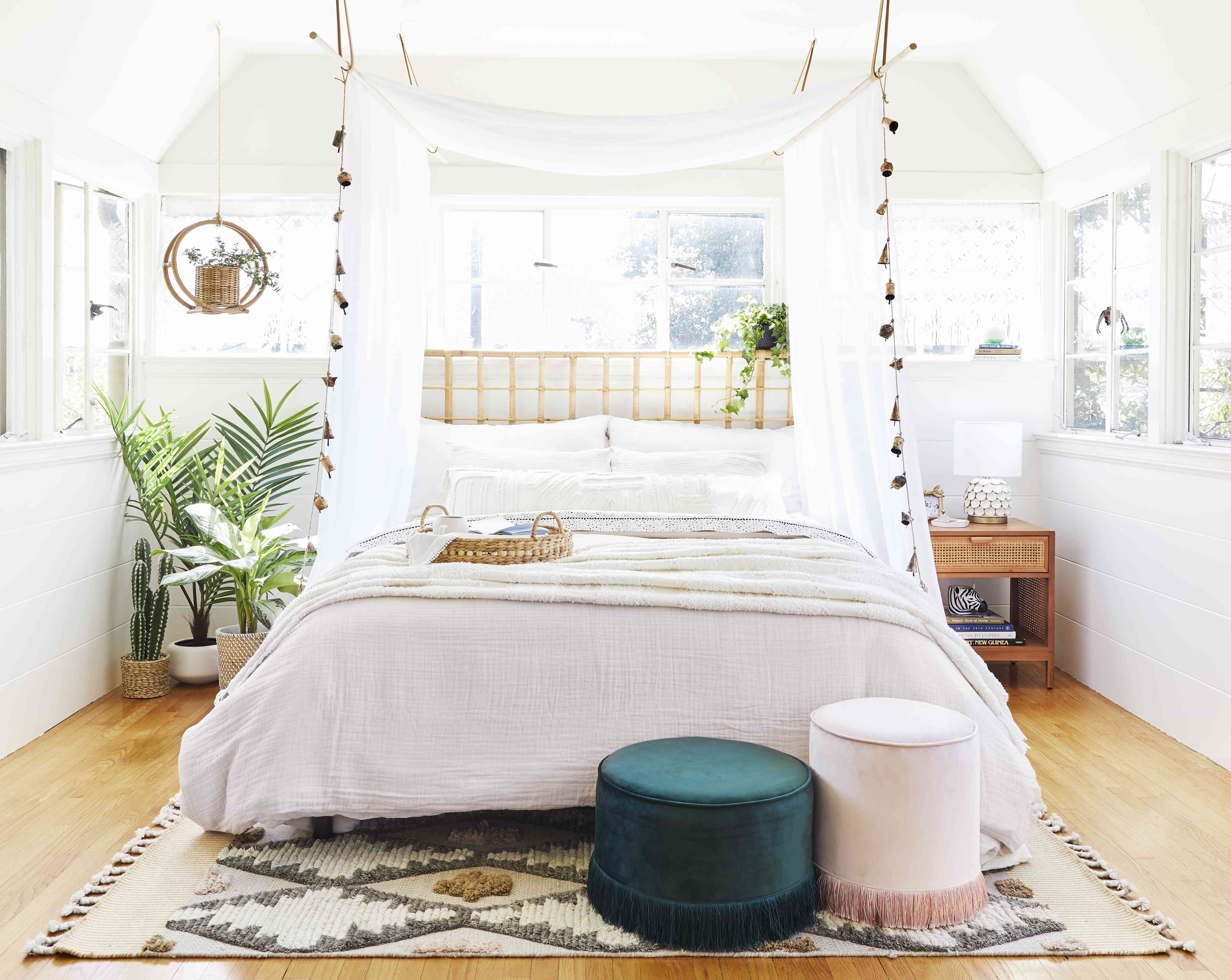 White bedroom with canopy and tropical touches