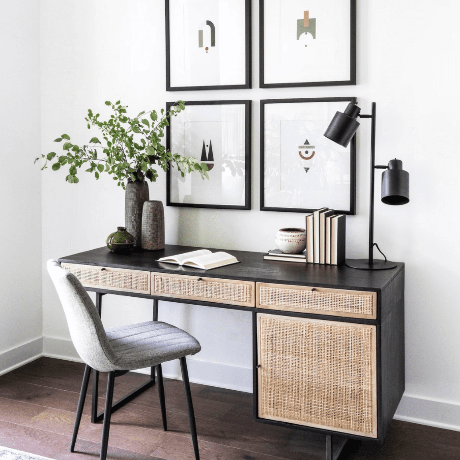 A home workspace filled with midcentury modern furniture and decorated with several sleek framed prints