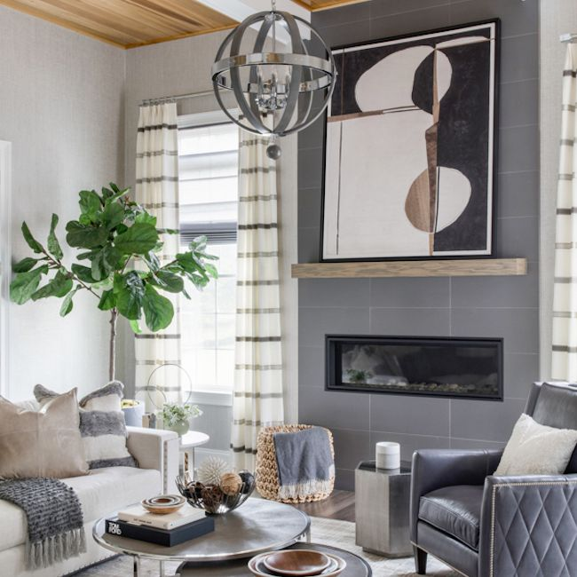 Sitting room with wooden panels in ceiling