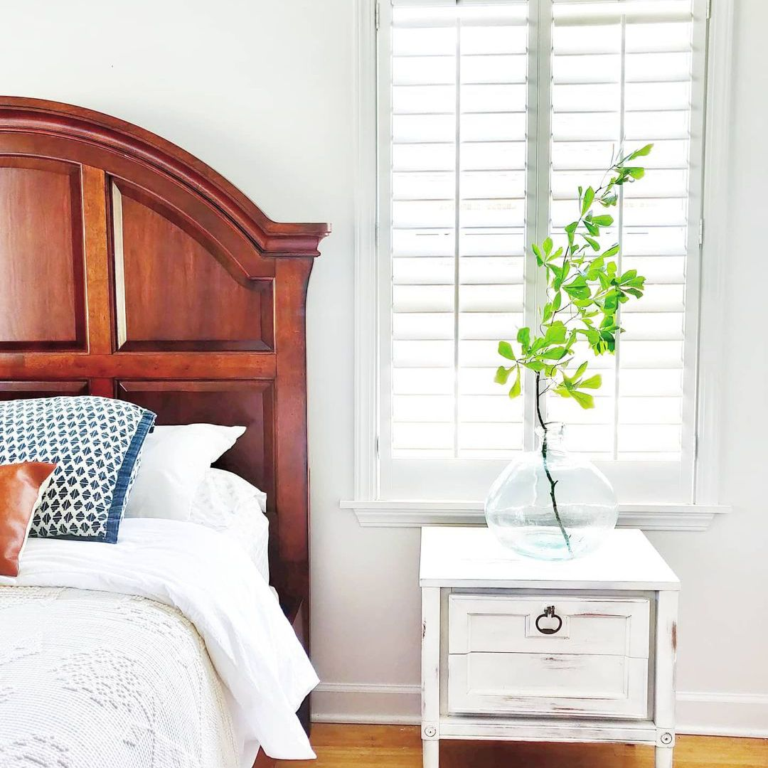 Bright bedroom with window blinds.