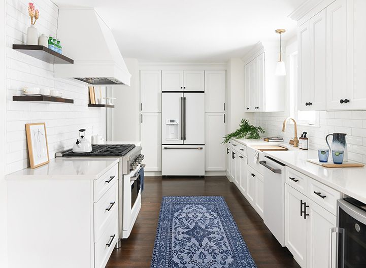 All white kitchen with blue printed runner
