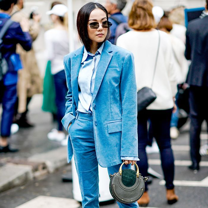 a woman in a teal blue suit