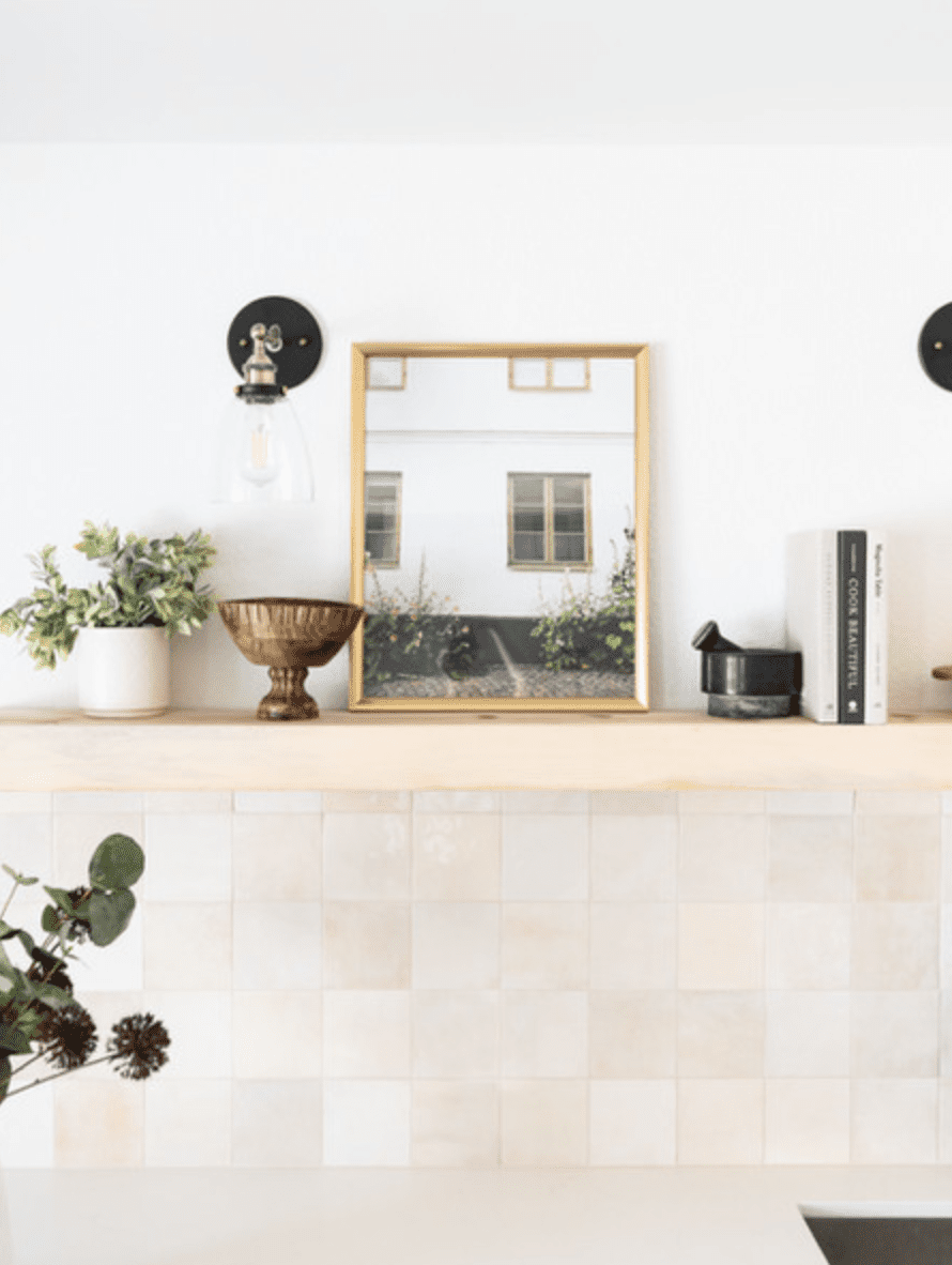 A kitchen lined with warm off-white tiles