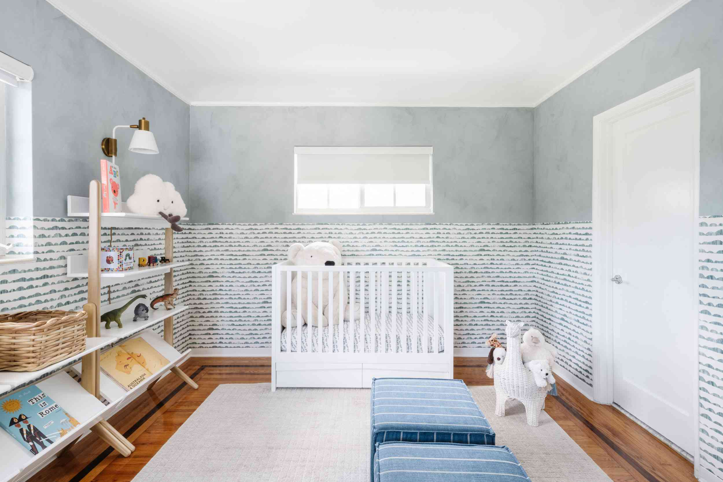 Baby boy nursery with wave wallpaper.