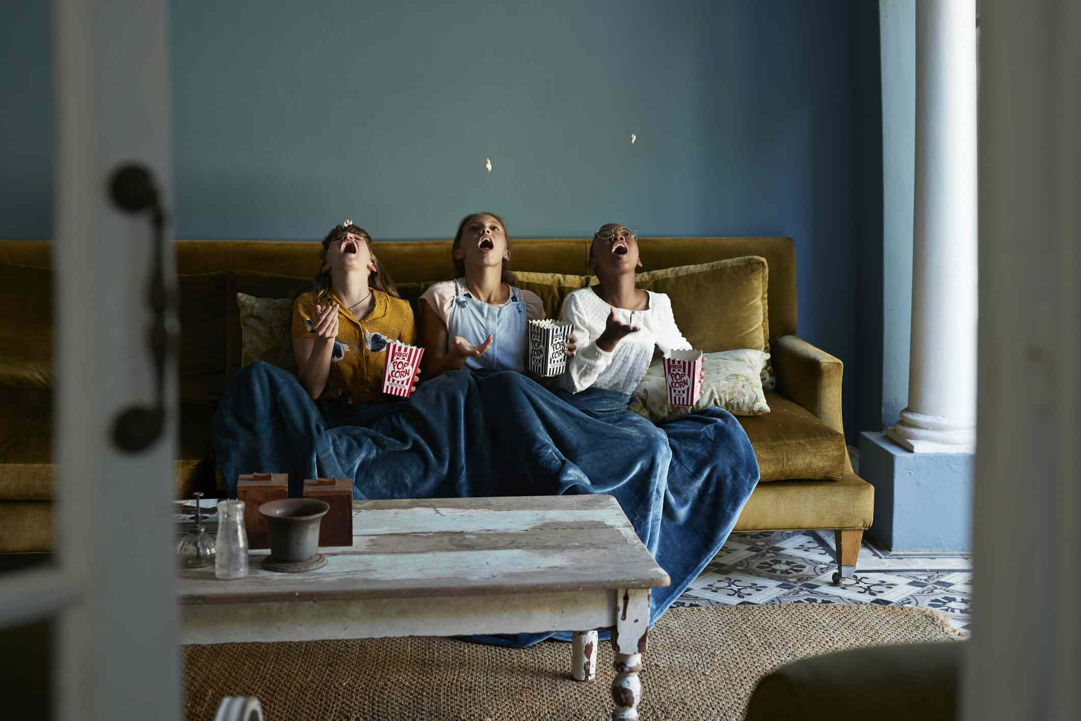 friends watching movie on couch