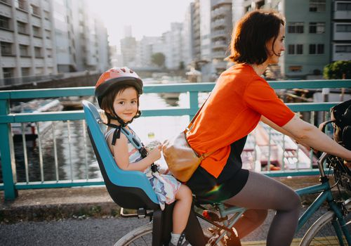 Child and mom riding bike