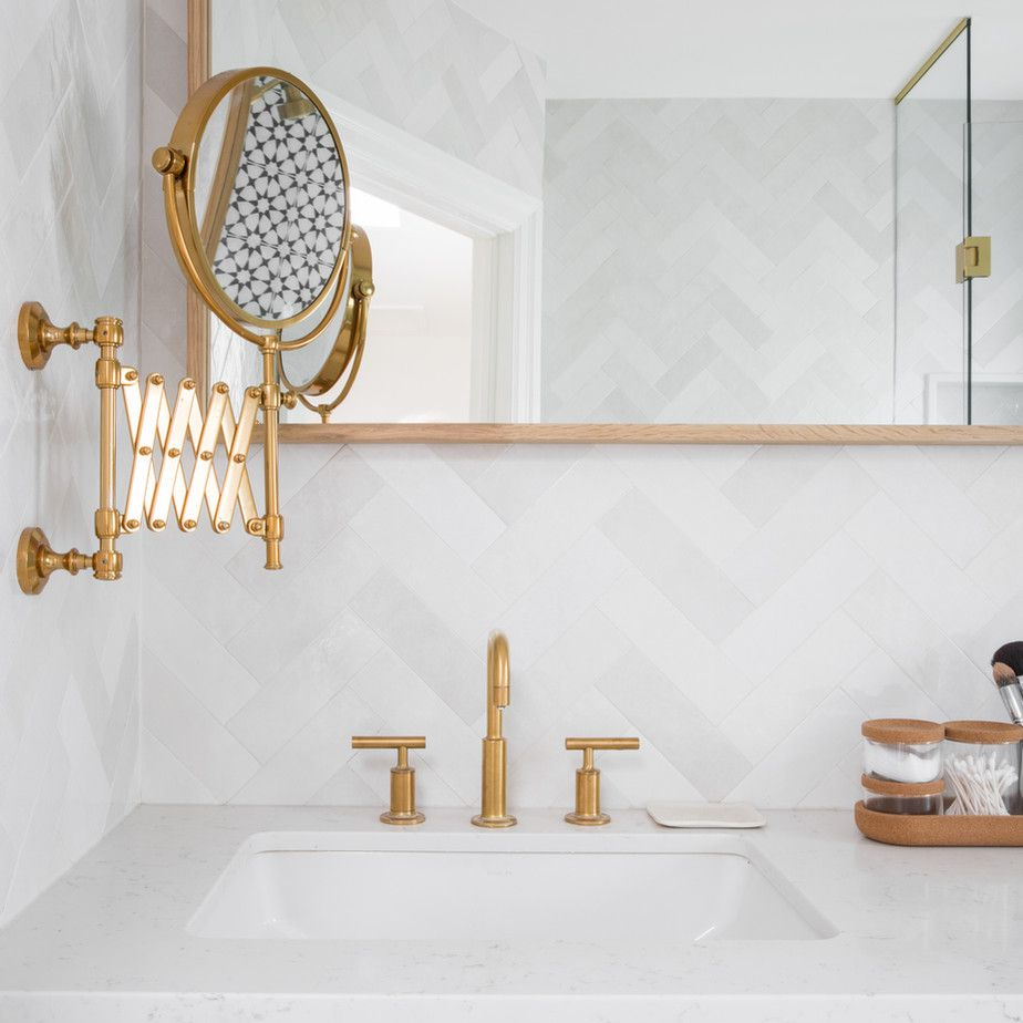 Organized bathroom vanity with wood and gold accents