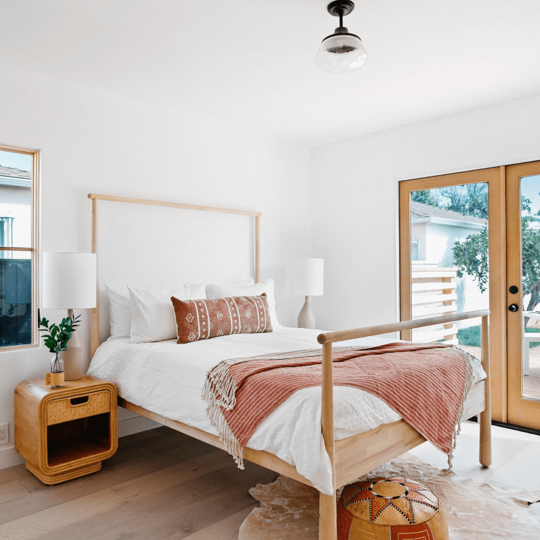 A bedroom with a wooden bed frame