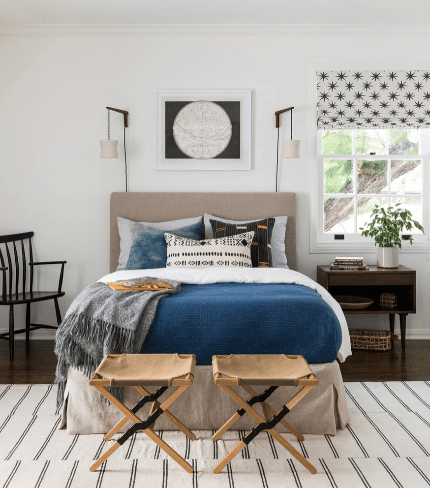 A maximalist bedroom with printed fabric blinds