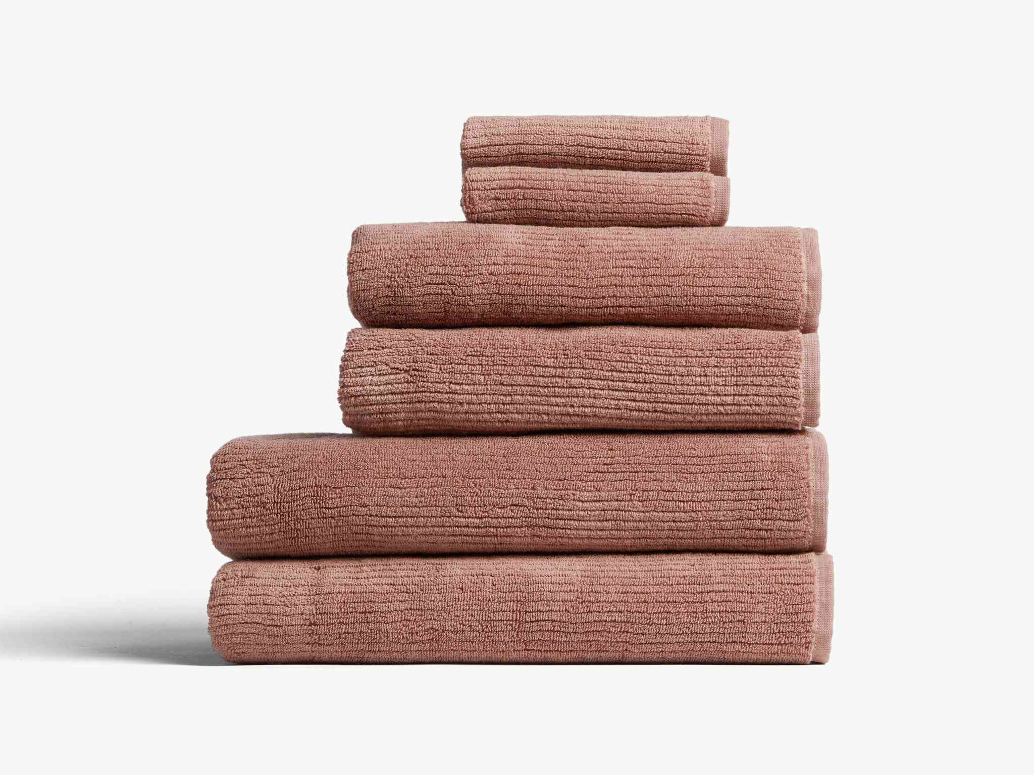 A pile of blush towels, currently for sale at Parachute
