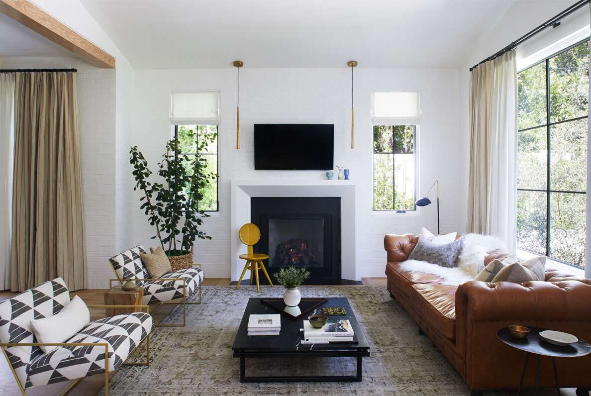 living room with painted white brick wall modern style