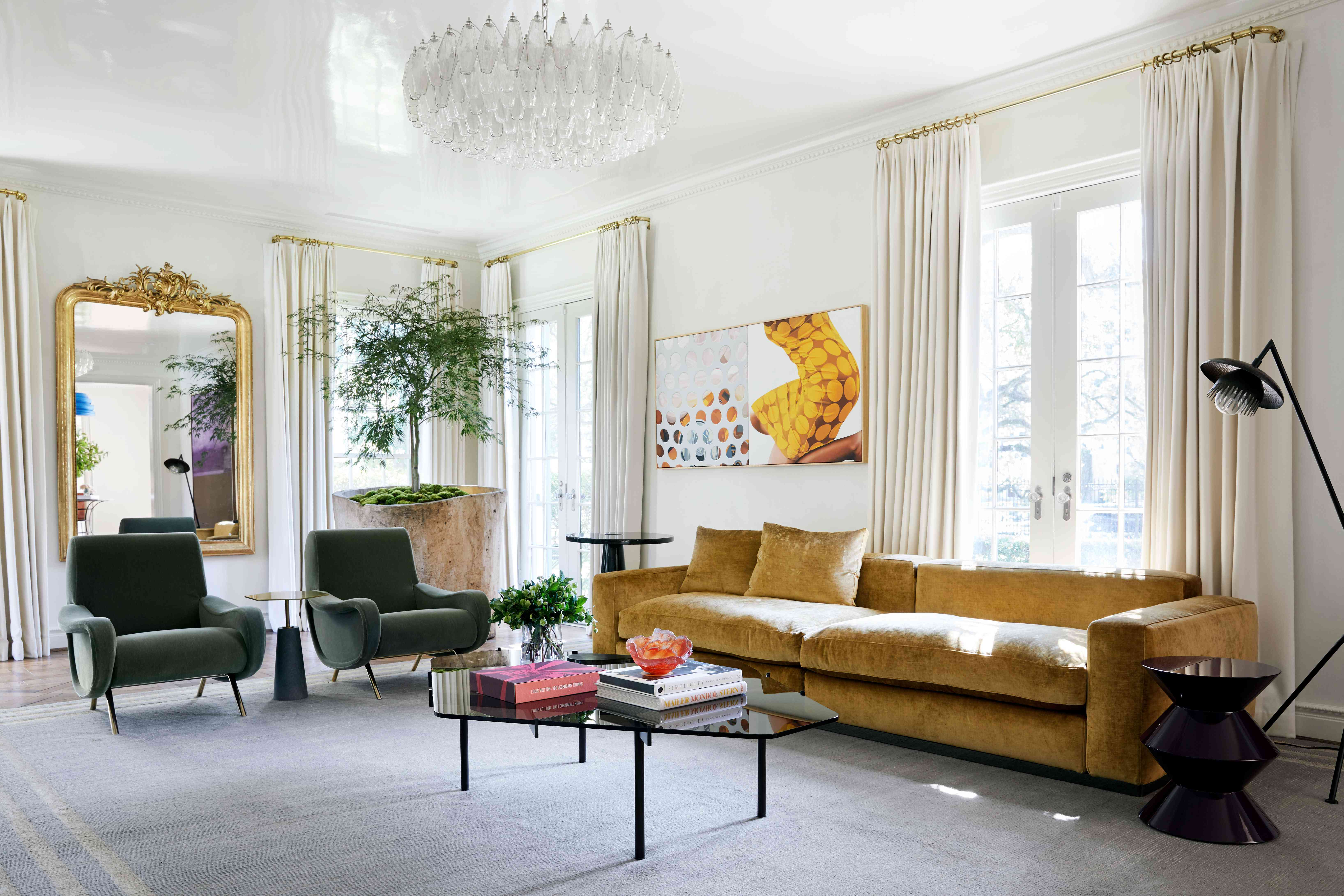 Eclectic living room with yellow velvet sofa.