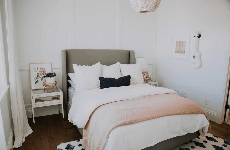 Bedroom with pink blanket