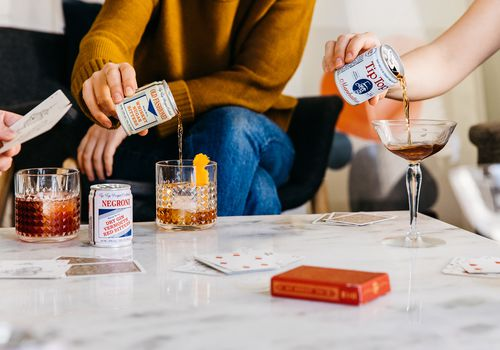 why canned cocktails are trending - tip top cocktails being poured in glass