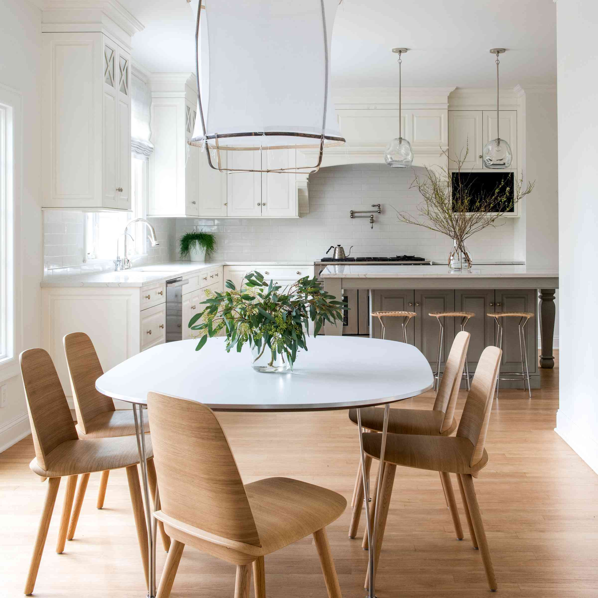 Simple kitchen dining set with large chandelier above.