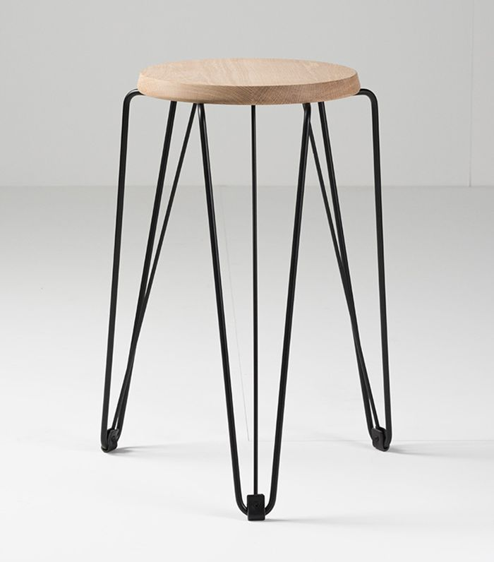 A round stool with an oak seat and iron hairpin legs.