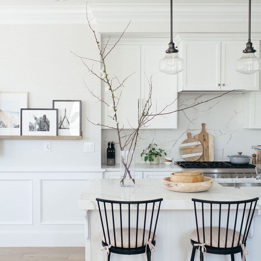 A white kitchen with black accents