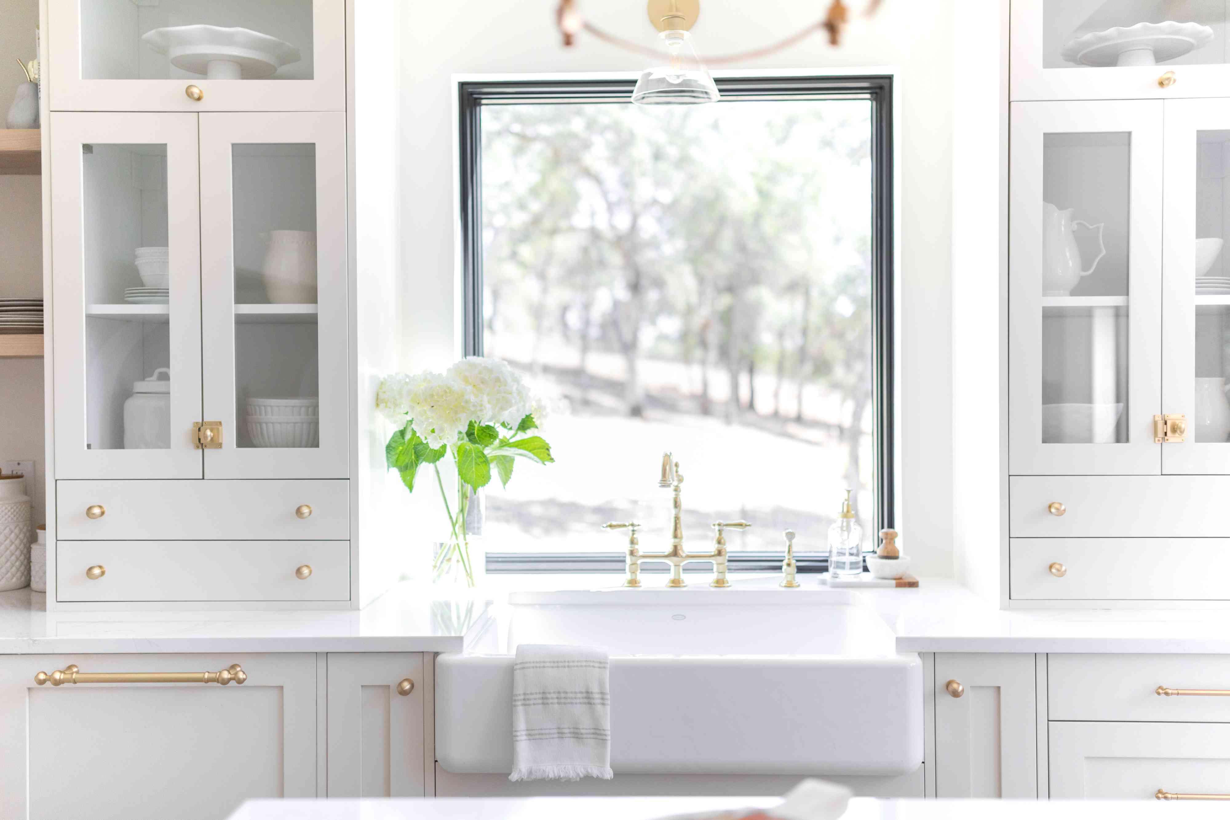 White kitchen sink and window.