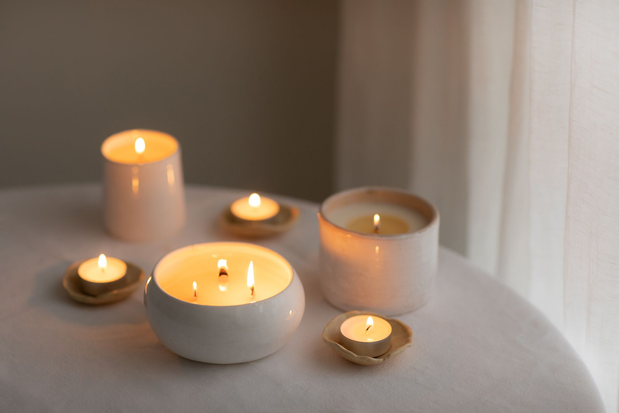 A group of candles on a table