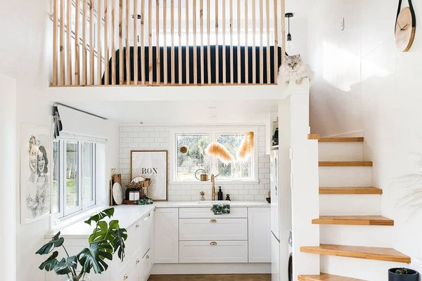 White and bright tiny home exterior with two stories.