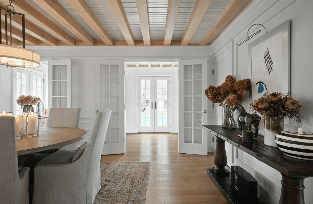 Bright living space with exposed wood beams.