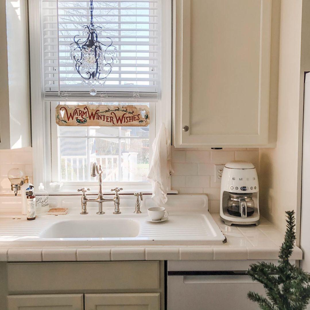 Kitchen with white tile countertops
