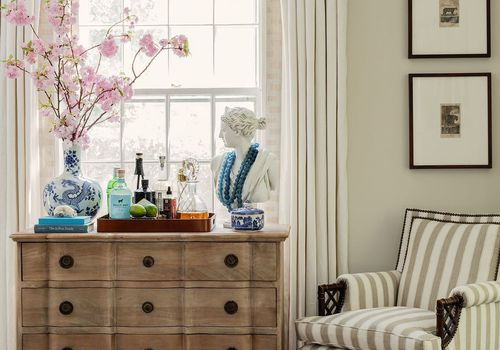 Classic dresser with bar cart essentials on top.