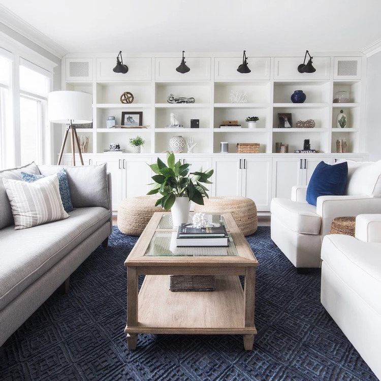 Blue and white living room with wooden coffee table