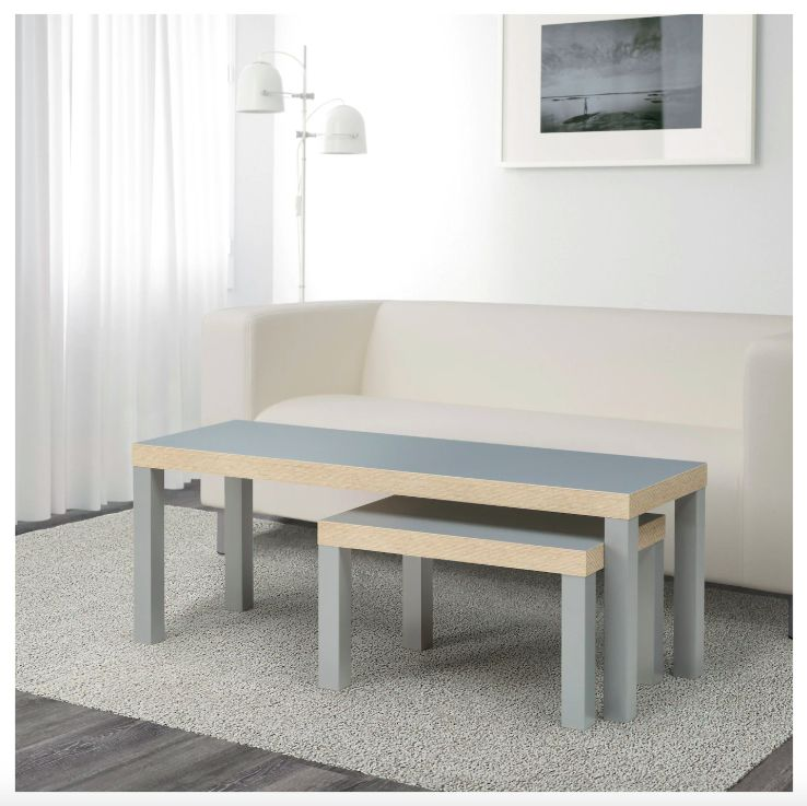A set of two rectangular gray nesting tables.