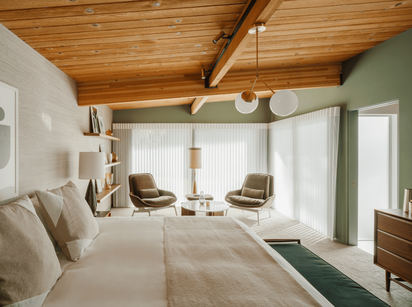 A bedroom lined with sage green walls